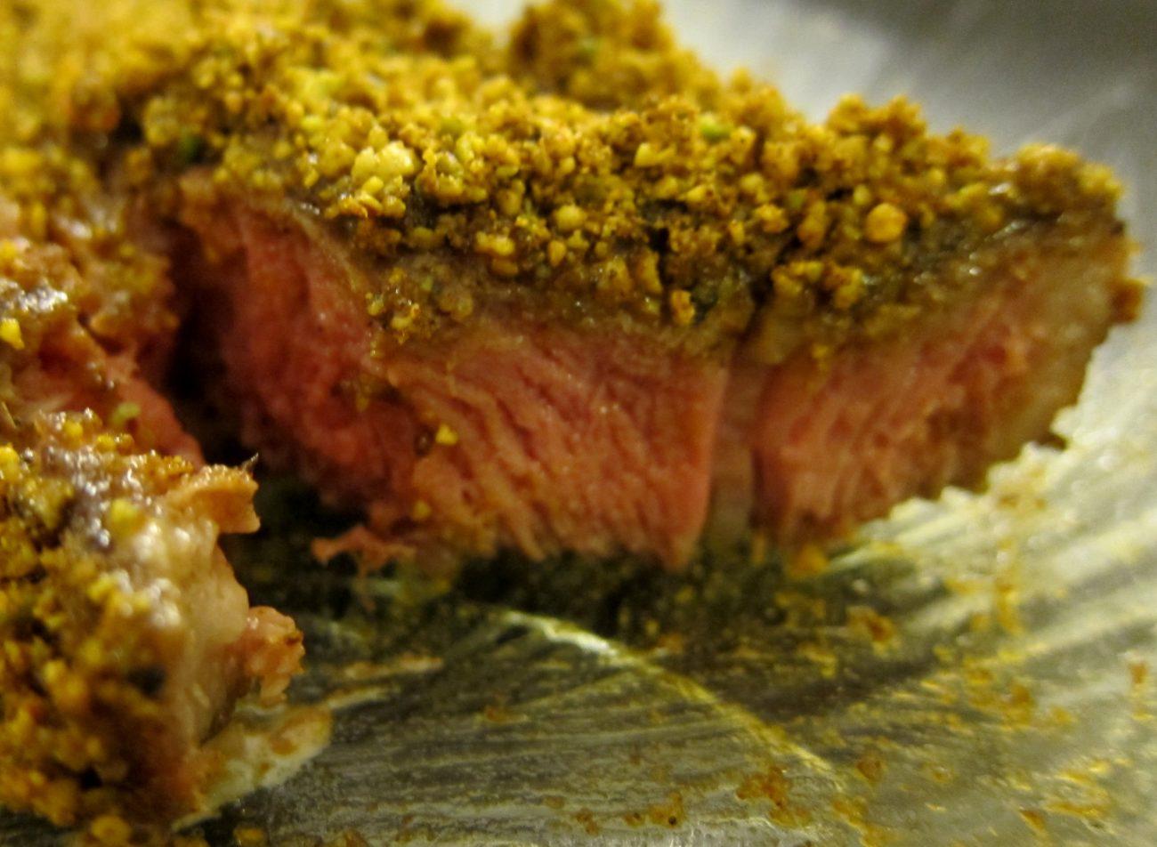 Agnello ai pistacchi di Bronte e spinaci